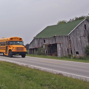 Indiana School Bus Passing Derelict Barn