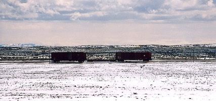 Rail cars on snow-covered Idaho prairie