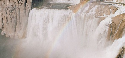 Shoshone Falls in full flow with rainbow